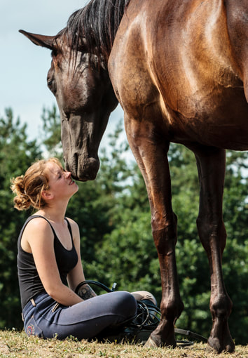 Young women and horse enjoying each others company